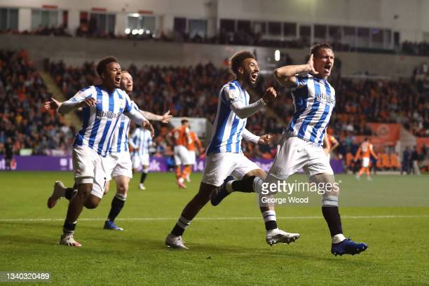 Jonathan Hogg of Huddersfield Town celebrates with teammates Josh Koroma and Sorba Thomas after scoring their side's third goal during the Sky Bet...