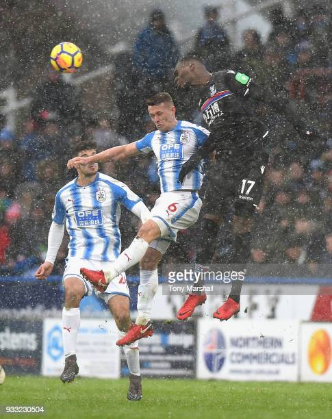 Jonathan Hogg of Huddersfield Town challenges Christian Benteke of Crystal Palace during the Premier League match between Huddersfield Town and...