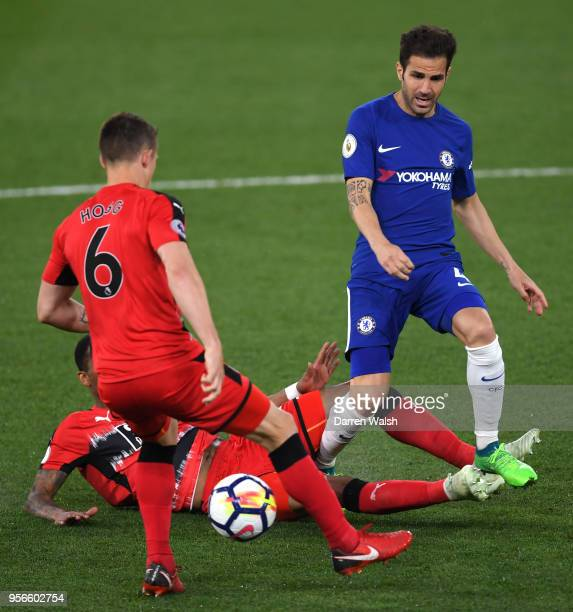 Jonathan Hogg of Huddersfield Town controls the ball infront of Rajiv van La Parra of Huddersfield Town and Cesc Fabregas of Chelsea during the...