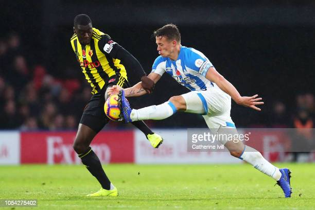 Jonathan Hogg of Huddersfield Town controls the ball while under pressure from Ken Sema of Watford during the Premier League match between Watford FC...
