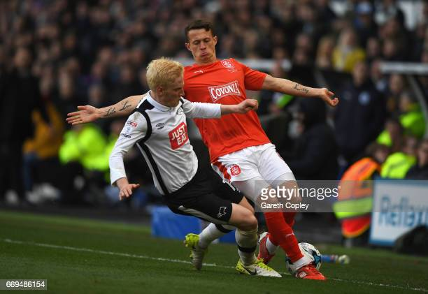 Jonathan Hogg of Huddersfield Town is challenged by Will Hughes of Derby County during the Sky Bet Championship match between Derby County and...