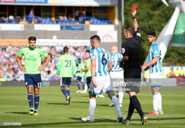Jonathan Hogg of Huddersfield Town is shown a red card by referee, Michael Oliver during the Premier League match between Huddersfield Town and...