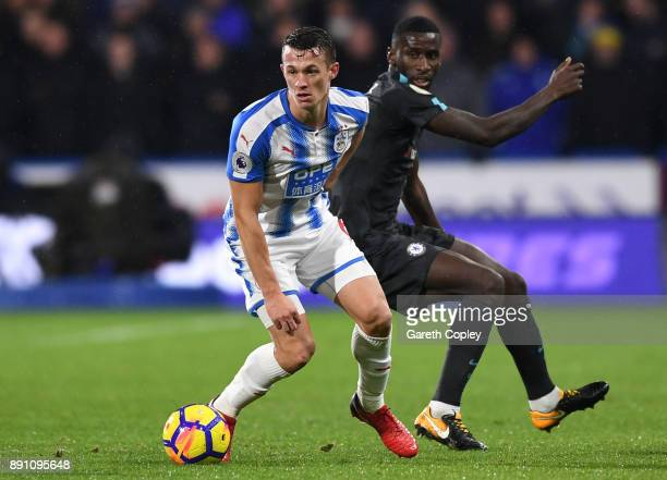 Jonathan Hogg of Huddersfield Town runs with the ball away from Tiemoue Bakayoko of Chelsea during the Premier League match between Huddersfield Town...