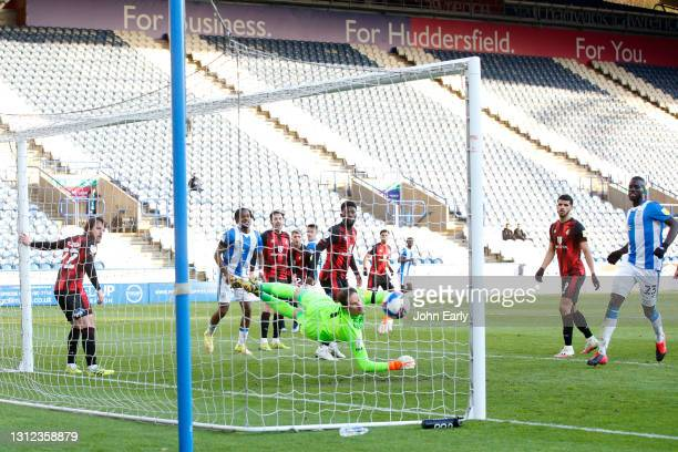 Jonathan Hogg of Huddersfield Town scores with a header past Asmir Begović of AFC Bournemouth during the Sky Bet Championship match between...