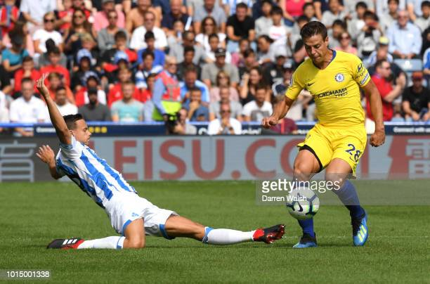 Jonathan Hogg of Huddersfield Town tackles Cesar Azpilicueta of Chelsea during the Premier League match between Huddersfield Town and Chelsea FC at...