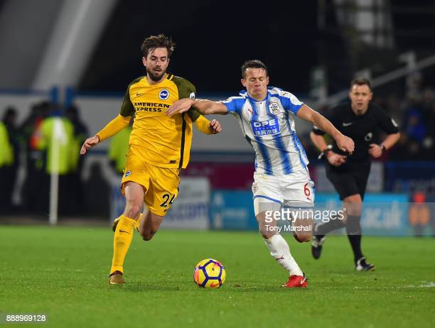 Jonathan Hogg of Huddersfield Town tackles Davy Propper of Brighton and Hove Albion during the Premier League match between Huddersfield Town and...