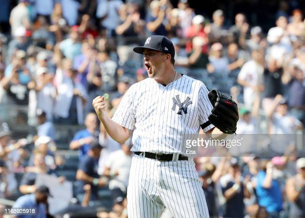 Jonathan Holder of the New York Yankees celebrates the 92 win over the Boston Red Sox after game one of a double header at Yankee Stadium on August...