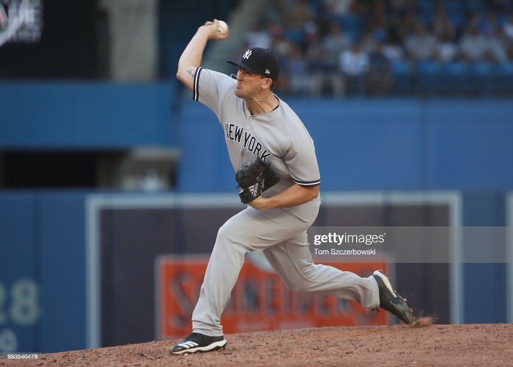 Jonathan Holder #56 of the New York Yankees delivers a pitch in the sixth inning during MLB game action against the Toronto Blue Jays at Rogers Centre on July 7, 2018 in Toronto, Canada.