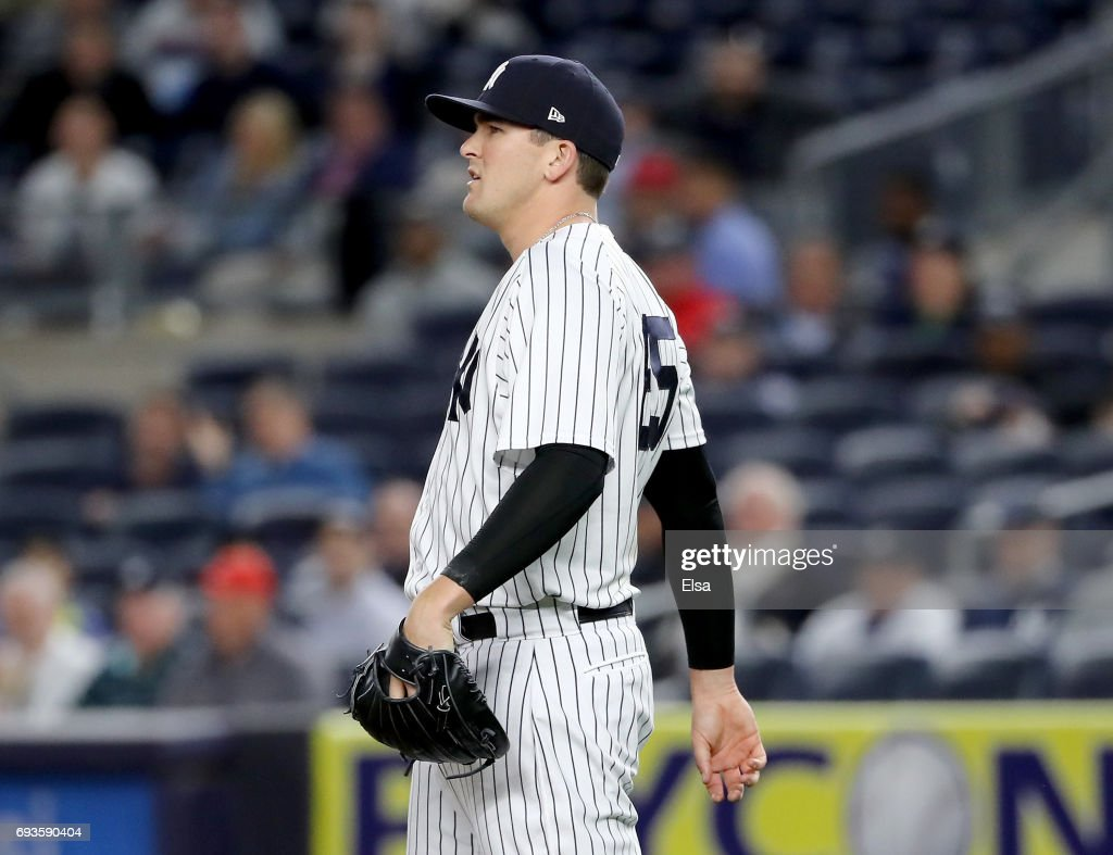 Jonathan Holder #65 of the New York Yankees watches the last out in the ninth inning against the Boston Red Sox on June 7, 2017 at Yankee Stadium in the Bronx borough of New York City.