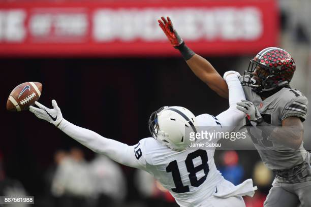 Jonathan Holland of the Penn State Nittany Lions is unable to make the catch as he is fouled by Jerome Baker of the Ohio State Buckeyes in the second...