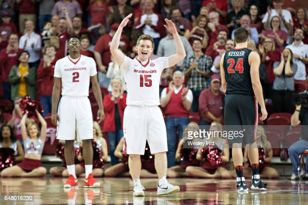 Jonathan Holmes of the Arkansas Razorbacks celebrates after making a bucket during a game against the Georgia Bulldogs at Bud Walton Arena on March 4...