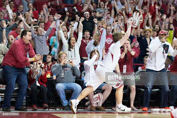 Jonathan Holmes of the Arkansas Razorbacks celebrates after making a bucket during a game against the Georgia Bulldogs at Bud Walton Arena on March...