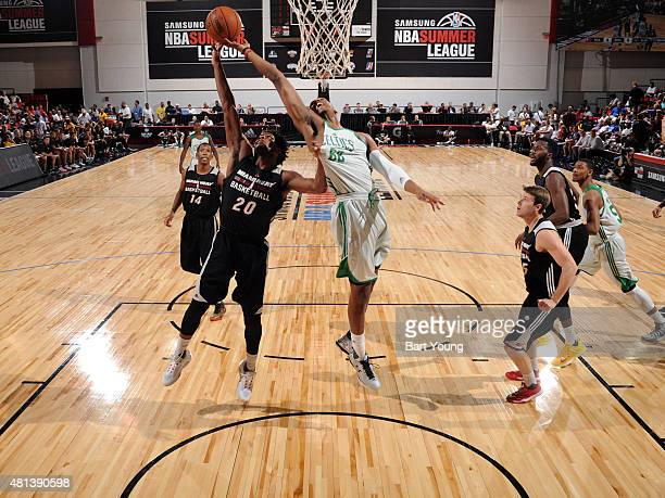 Jonathan Holmes of the Boston Celtics shoots against Justise Winslow of the Miami Heat during a game on July 14 2015 at The Cox Pavilion in Las Vegas...