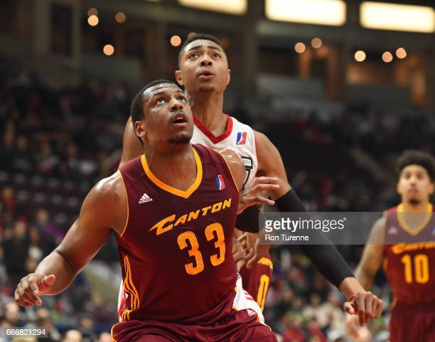Jonathan Holmes of the Canton Charge fights for the rebound with Bruno Caboclo of the Raptors 905 at the Hershey Centre on April 8 2017 in...