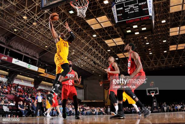 Jonathan Holmes of the Canton Charge goes up for the dunk against Antwaine Wiggins of the Raptors 905 at the Canton Memorial Civic Center on April 5...