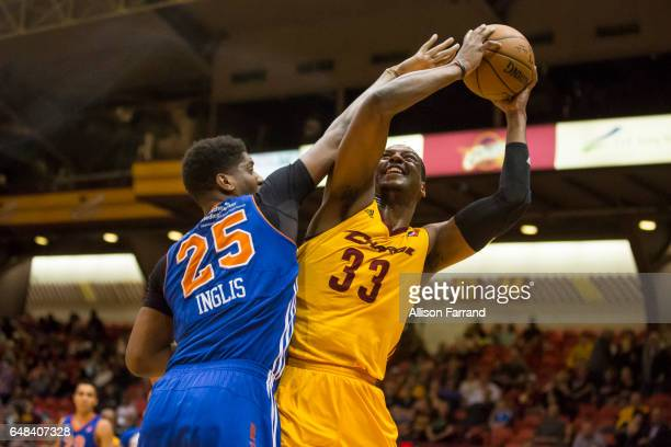 Jonathan Holmes of the Canton Charge looks to shoot through coverage by Damien Inglis of the Westchester Knicks at the Canton Memorial Civic Center...
