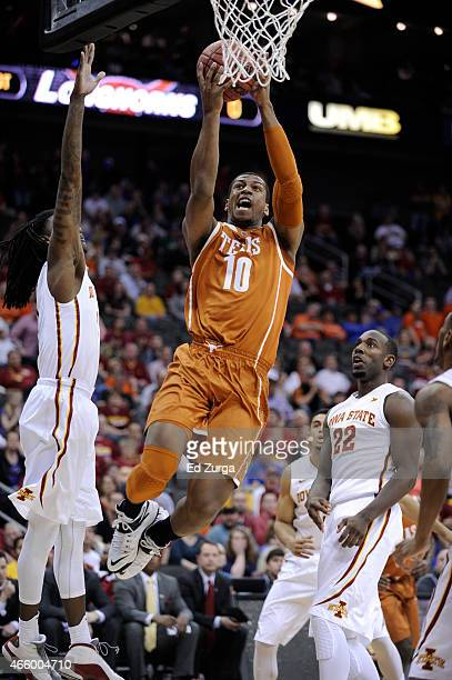 Jonathan Holmes of the Texas Longhorns goes up for a shot against Jameel McKay Dustin Hogue of the Iowa State Cyclones during the quarterfinal round...