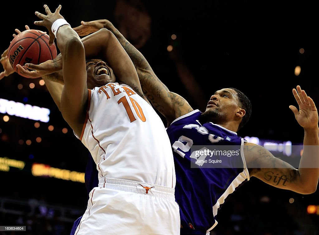 Jonathan Holmes #10 of the Texas Longhorns is fouled by Adrick McKinney #24 of the TCU Horned Frogs during the first round of the 2013 Big 12 Men's Basketball Championship at Sprint Center on March 13, 2013 in Kansas City, Missouri.