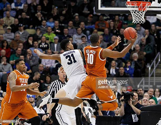 Jonathan Holmes of the Texas Longhorns shoots against Kameron Woods of the Butler Bulldogs in the first half during the second round of the 2015 NCAA...