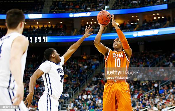 Jonathan Holmes of the Texas Longhorns shoots over Kelan Martin of the Butler Bulldogs in the first half during the second round of the 2015 NCAA...