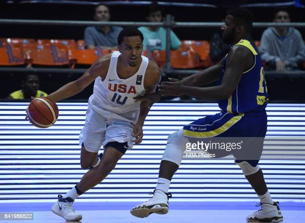 Jonathan Holmes of United States fights for the ball with Khalid Hart of Virgin Islands during the FIBA Americup semi final match between US and...