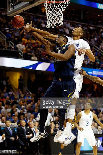 Jonathan Holton of the West Virginia Mountaineers goes up with the ball against Marcus Lee of the Kentucky Wildcats in the first half during the...