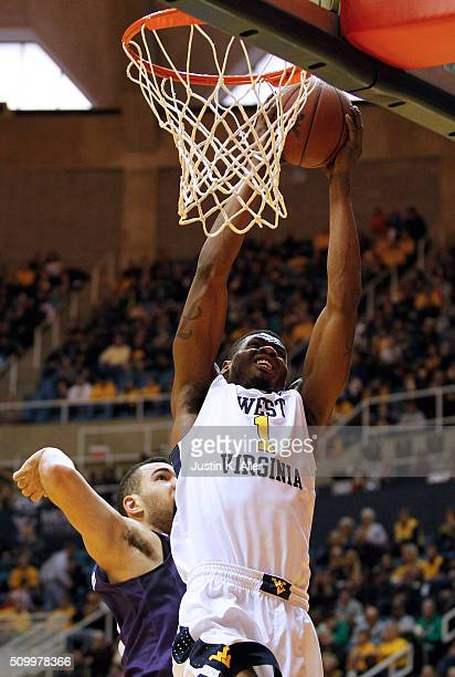 Jonathan Holton of the West Virginia Mountaineers lays one in during the game against the TCU Horned Frogs at the WVU Coliseum on February 13 2016 in...