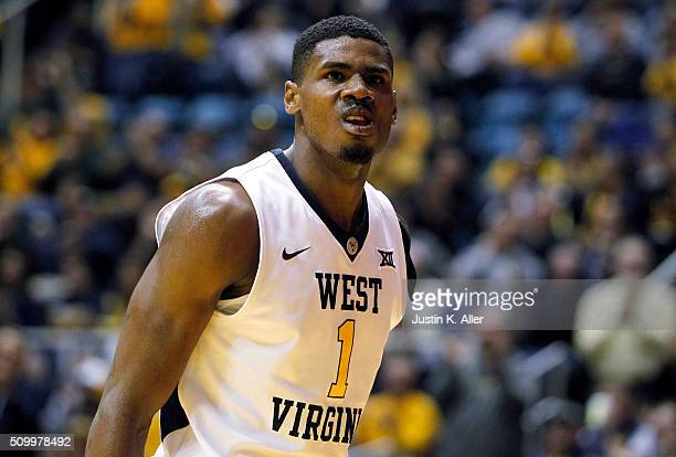 Jonathan Holton of the West Virginia Mountaineers reacts after a dunk during the game against the TCU Horned Frogs at the WVU Coliseum on February 13...