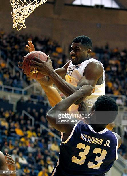 Jonathan Holton of the West Virginia Mountaineers rebounds the ball against Chris Washburn of the TCU Horned Frogs during the game at the WVU...