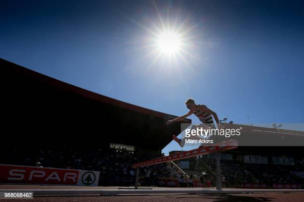 Jonathan Hopkins of Cardiff AAC in action during the Men's 3000m Steeplechase final during Day One of the Muller British Athletics Championships at...