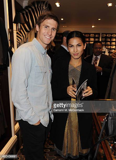 Jonathan Howard and Elodie Yung attend the Global Flagship tore launch party at Hackett London on November 28 2013 in London England
