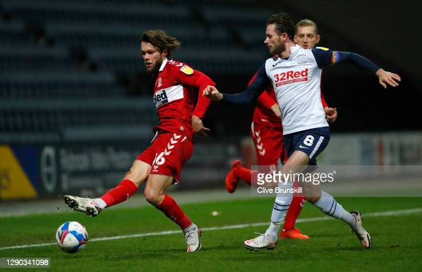 Jonathan Howson of Middlesbrough passes the ball under pressure from Alan Browne of Preston North End during the Sky Bet Championship match between...