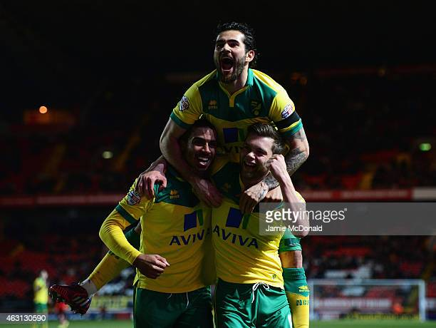 Jonathan Howson of Norwich celebrates scoring the opening goal with team mates Bradley Johnson and Lewis Grabban of Norwich during the Sky Bet...