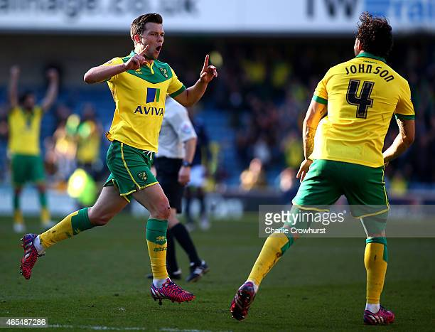 Jonathan Howson of Norwich celebrates with team mate Bradley Johnson after he scores the first goal of the game during the Sky Bet Championship match...