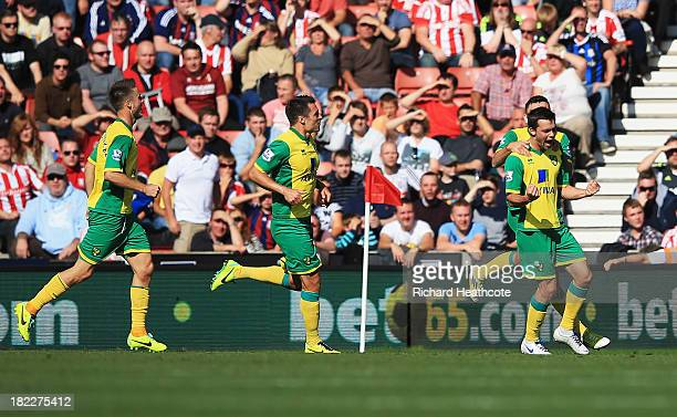 Jonathan Howson of Norwich City celebrates the opening goal with team mates during the Barclays Premier League match between Stoke City and Norwich...
