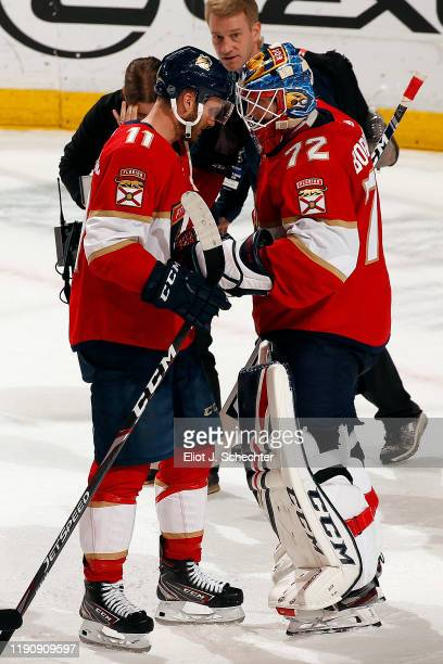 Jonathan Huberdeau and Goaltender Sergei Bobrovsky of the Florida Panthers celebrate their 6-5 win over the Montreal Canadiens at the BB&T Center on...