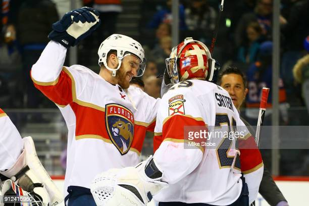Jonathan Huberdeau and Harri Sateri of the Florida Panthers celebrate a 41 win over the New York Islanders at Barclays Center on January 30 2018 in...