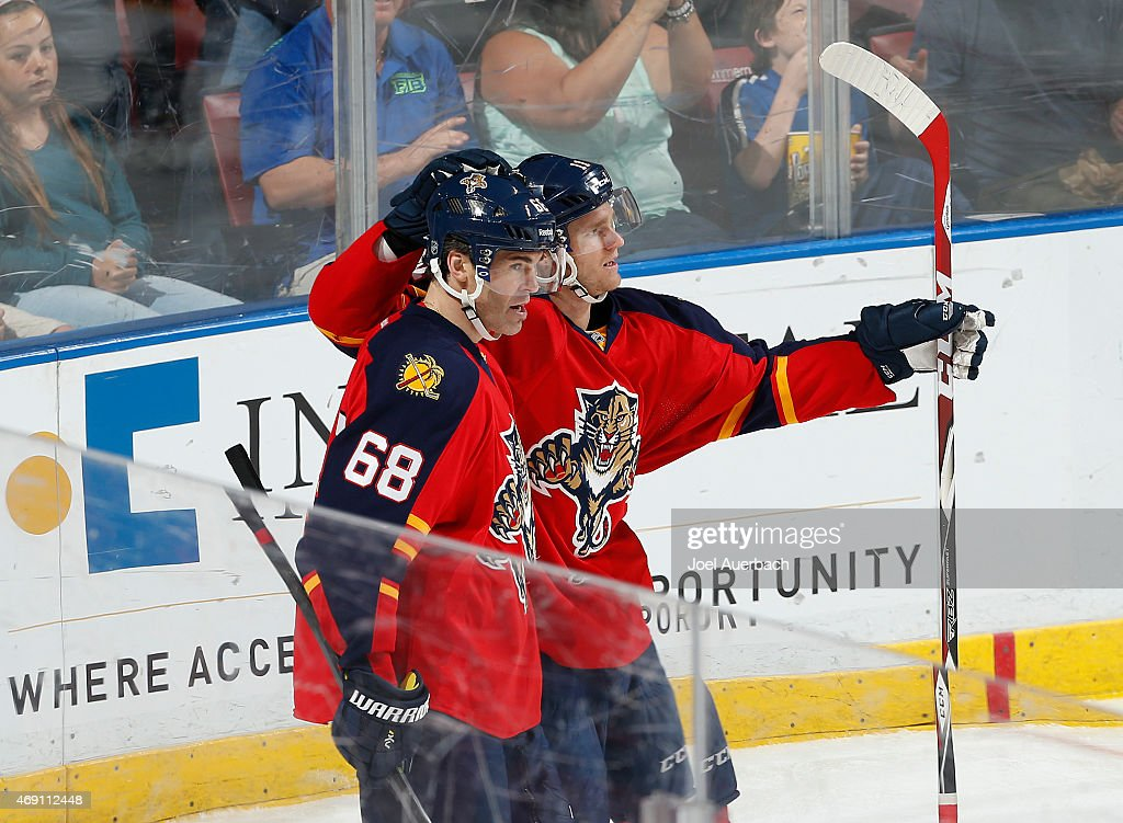 Jonathan Huberdeau #11 celebrates his third period goal with Jaromir Jagr #68 of the Florida Panthers against the Boston Bruins at the BB&T Center on April 9, 2015 in Sunrise, Florida. Jagr received an assist on the play which was his 1,800th point in the NHL. The Panthers defeated the Bruins 4-2.