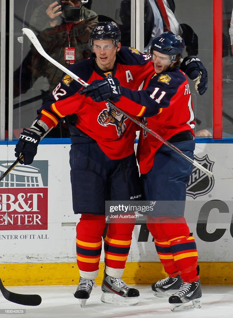 Jonathan Huberdeau #11 is congratulated by Tomas Kopecky #82 of the Florida Panthers after he scored a third period goal against the Carolina Hurricanes at the BB&T Center on March 3, 2013 in Sunrise, Florida. The Hurricanes defeated the Pnthers 3-2.