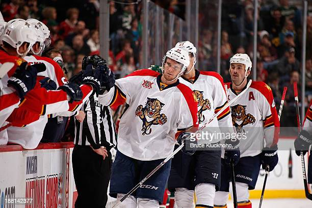 Jonathan Huberdeau Nick Bjugstad and Erik Gudbranson of the Florida Panthers are congratulated by teammates after a goal against the Minnesota Wild...