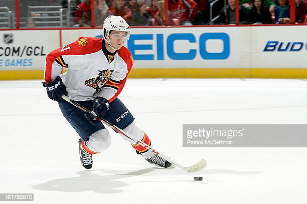 Jonathan Huberdeau of the Florida Panthers brings the puck up ice during an NHL hockey game against the Washington Capitals at Verizon Center on...