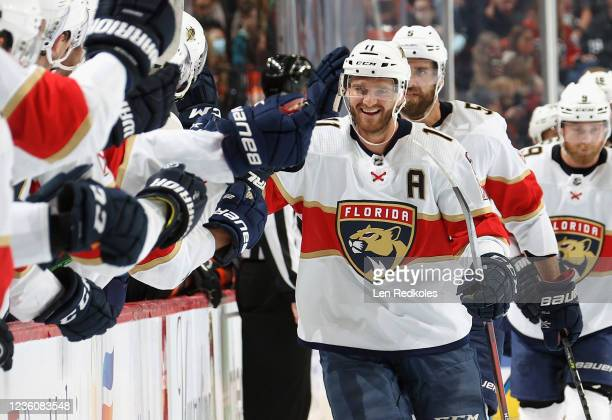 Jonathan Huberdeau of the Florida Panthers celebrates his first period power-play goal against the Philadelphia Flyers with his teammates on the...