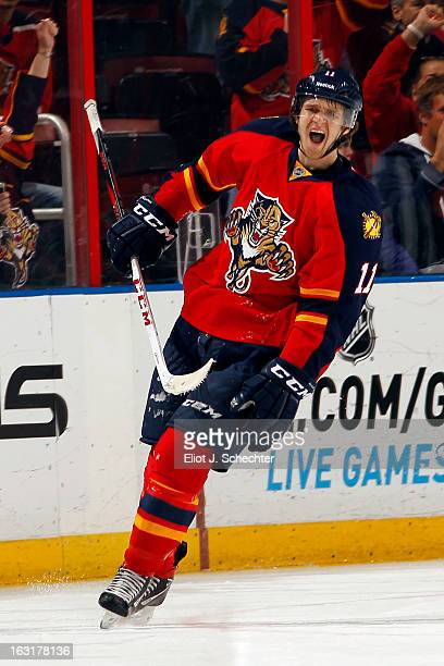 Jonathan Huberdeau of the Florida Panthers celebrates his goal from a penalty shot against the Winnipeg Jets at the BBT Center on March 5 2013 in...