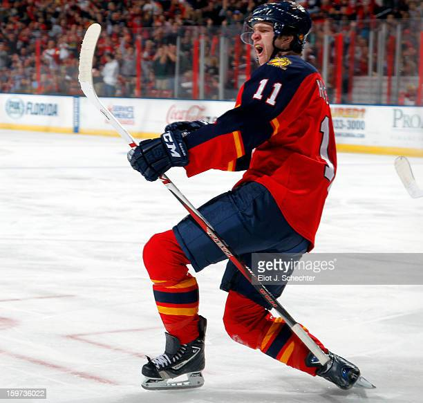 Jonathan Huberdeau of the Florida Panthers celebrates his goal against the Carolina Hurricanes at the BBT Center on January 19 2013 in Sunrise Florida