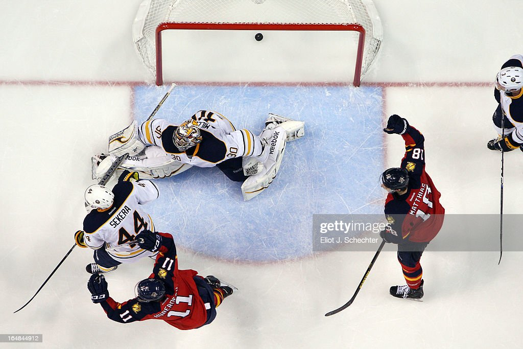 Jonathan Huberdeau #11 of the Florida Panthers celebrates his goal to tie the game with teammate Shawn Matthias #18 against Goaltender Ryan Miller #30 of the Buffalo Sabres at the BB&T Center on March 28, 2013 in Sunrise, Florida.