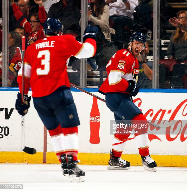 Jonathan Huberdeau of the Florida Panthers celebrates his goal with teammate Keith Yandle during the second period against the Vancouver Canucks at...
