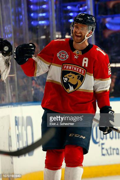 Jonathan Huberdeau of the Florida Panthers celebrates his goal with teammates during the second period against the New York Rangers at the BBT Center...