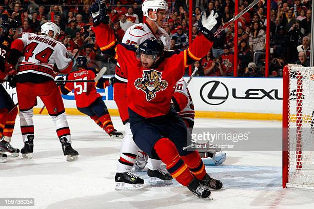 Jonathan Huberdeau of the Florida Panthers celebrates his teammate Brian Campbell goal against the Carolina Hurricanes at the BBT Center on January...