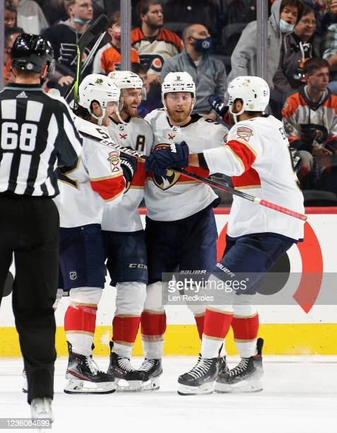 Jonathan Huberdeau of the Florida Panthers celebrates his third period shorthanded goal against the Philadelphia Flyers with MacKenzie Weegar, Sam...