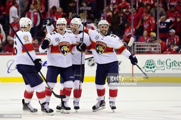 Jonathan Huberdeau of the Florida Panthers celebrates with his teammates after scoring the game winning goal during a shootout against the Washington...